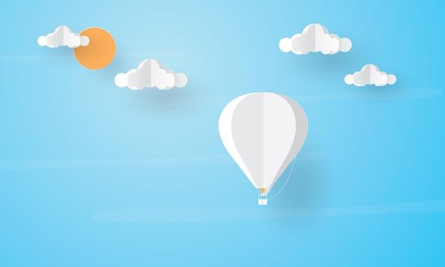 Papierkunst des heißluftballons, der über der wolke fliegt, feiertagskonzept