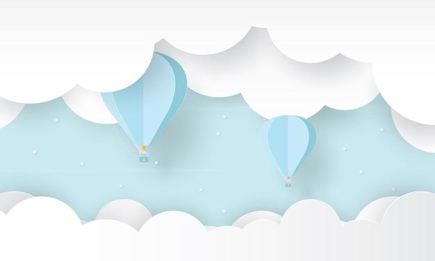 Papierkunst des heißluftballons, der über der wolke fliegt