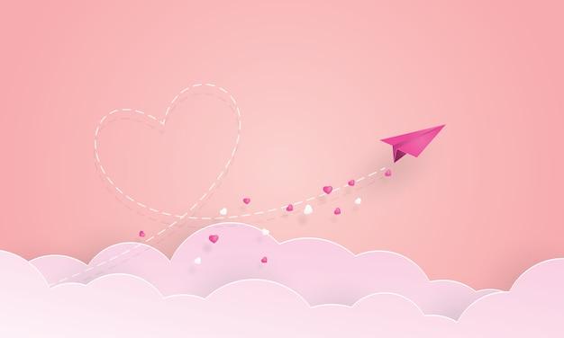 Papierkunst des papierflugzeuges fliegend zum himmel, valentinstag