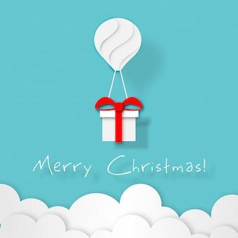 Papierkunst des weißen ballonfarbschwimmens und der geschenkbox an in den blauen himmel der luft
