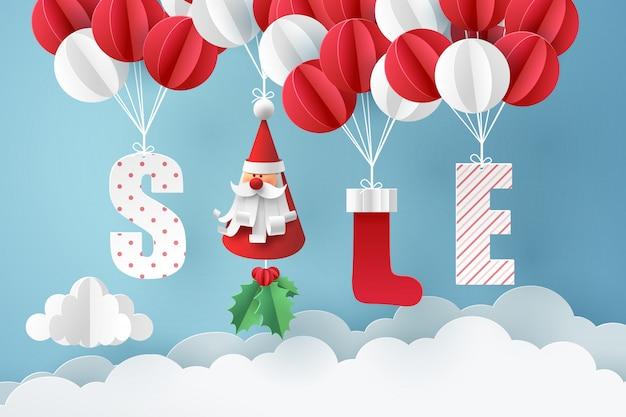 Papierkunst von santa claus und von rotem sockenmobile, die mit ballon auf himmel hängen