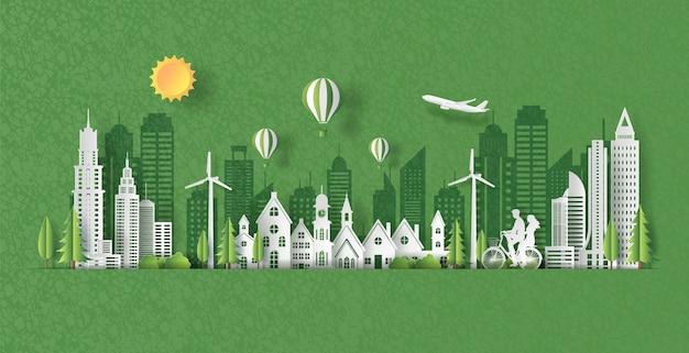 Papierkunstart der landschaft mit eco grüner stadt, glückliches paar, das zusammen auf fahrrad fährt.