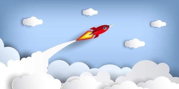 Papierkunstart der rakete fliegend über den himmel beim fliegen über eine wolke.