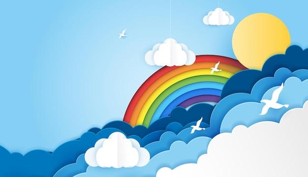 Papierkunstregenbogenfarben mit sonnenvogel und wolke im himmelregenbogen sind rot orange gelb