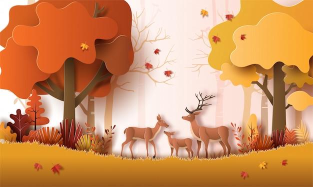 Papierkunststil der herbstlandschaft mit hirschfamilie in einem wald, viele schöne bäume und blätter.