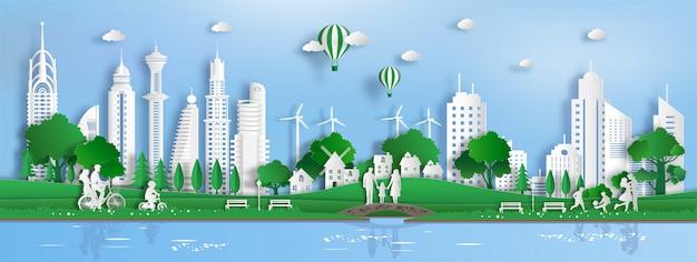 Papierkunststil der landschaft mit eco grüner stadt, leute genießen frische luft im park.