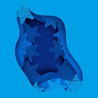 Papierkunstwinterhintergrund mit blauen papierschneeflocken frohe weihnachten und grußkarte des neuen jahres