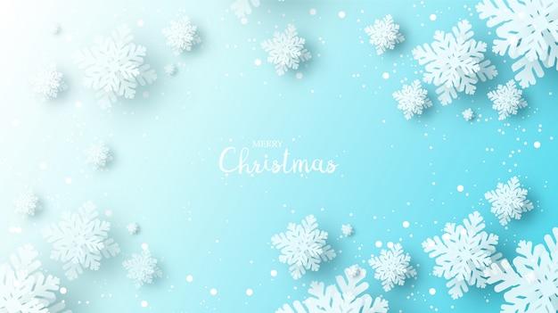 Papierschneeflocken mit schatten für winterhintergrund.