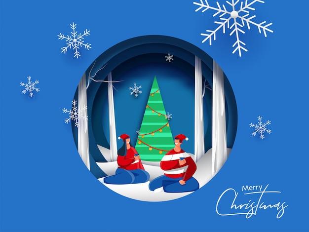 Papierschnitt-artgrußkarte mit dekorativem weihnachtsbaum und dem glücklichen paar, die getränke auf schneebedecktem für feier der frohen weihnachten genießt.