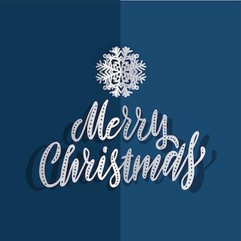Papierweihnachtsschneeflocken auf einem blauen hintergrund mit der hand gezeichneten bürste, die frohe weihnachten beschriftet