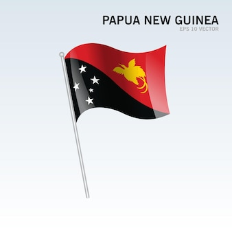 Papua-neuguinea wehende flagge isoliert auf grau