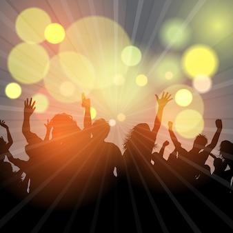 Partymenge auf einem bokeh-lichterhintergrund