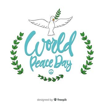 Peace day schriftzug mit taube