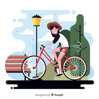 Person, die ein fahrrad im parkhintergrund reitet