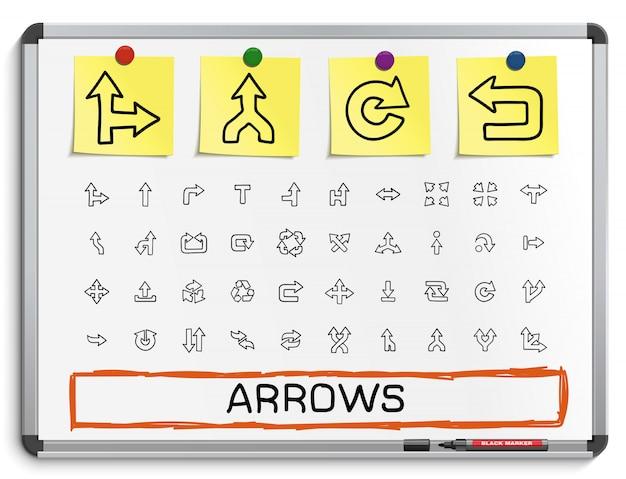 Pfeile hand zeichnen liniensymbole. gekritzelpiktogrammsatz, skizzenzeichenillustration auf weißer markierungstafel mit papieraufklebern