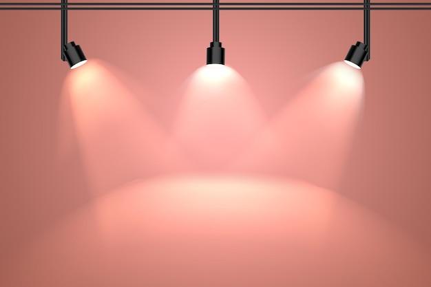 Pfirsichfarbene wand mit scheinwerferhintergrund