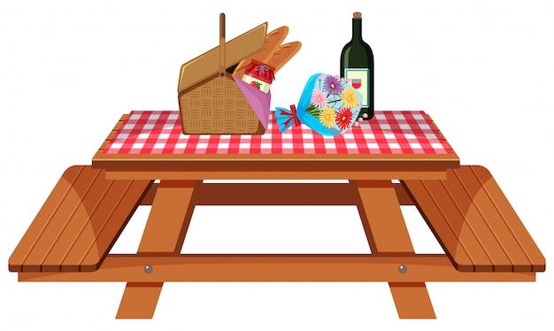 Picknicktisch mit essen und blumen auf weißem hintergrund