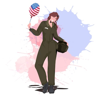 Pilotin in uniform mit ballon mit glücklichem arbeitstag der usa-flagge