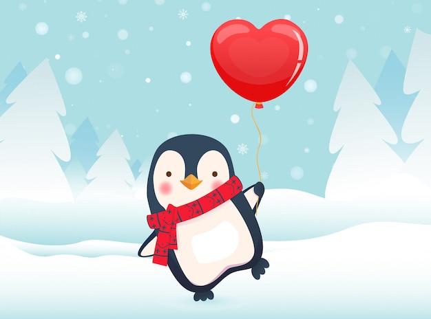Pinguin, der ballon hält