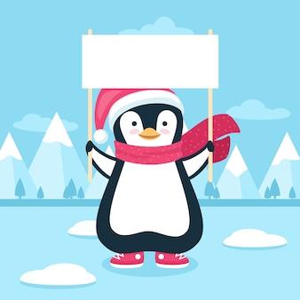 Pinguin, der eine leere fahne für weihnachten hält