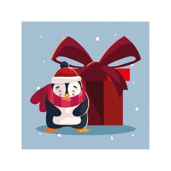 Pinguin mit geschenkbox in der winterlandschaft