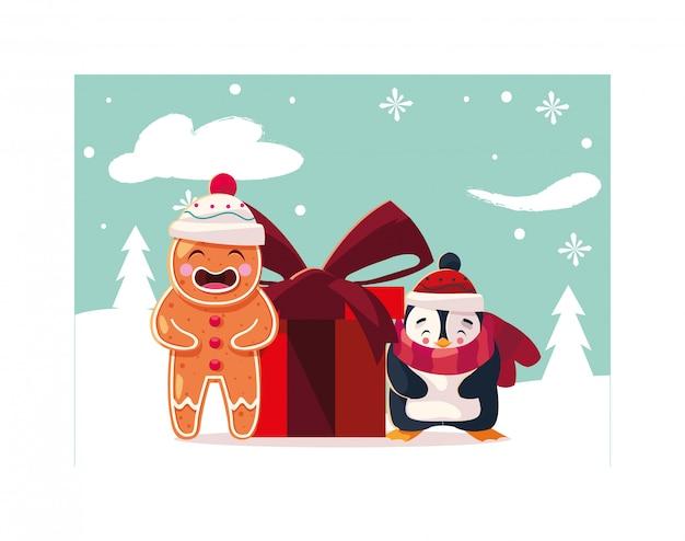 Pinguin- und lebkuchenmann mit geschenkbox in der winterlandschaft
