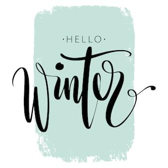 Pinselstift letterng. hallo winterphrase eigenhändig auf buntem hintergrundanschlag.