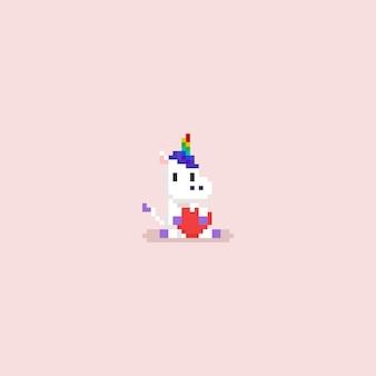 Pixel sitzen das einhorn, das ein rotes herz umarmt