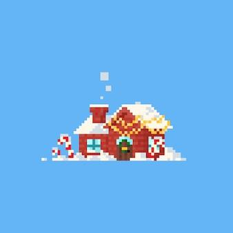Pixelhaus mit weihnachtshauptdekor und -schnee.