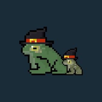 Pixelkunst-cartoon-froschcharaktere, die hexenhut tragen.