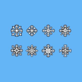 Pixelkunst-schneeflockenikonensatz.