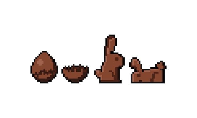 Pixelkunstkarikaturschokoladen-osterei und schokoladenhasen-symbolsatz.