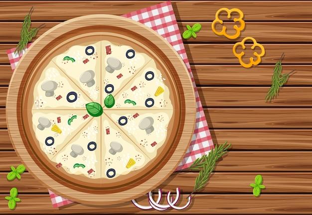 Pizza auf holztischhintergrund mit verschiedenem gemüse