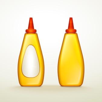 Plastikgelbe soßenflaschen mit leerem etikett, lokalisierter weißer hintergrund