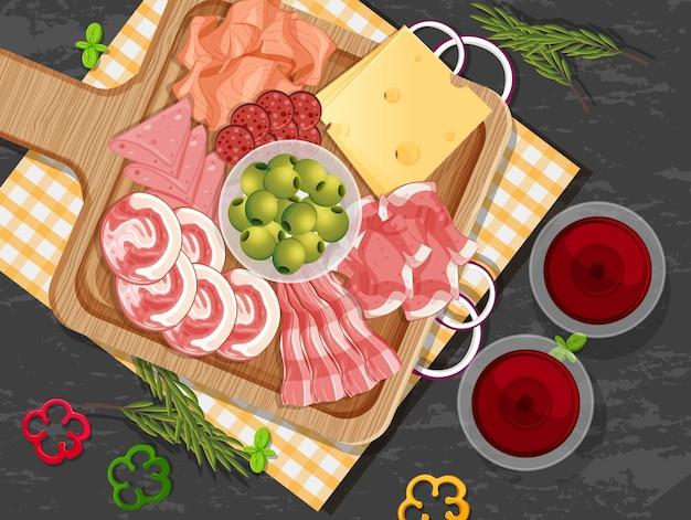 Platte mit aufschnitt und geräuchertem fleisch auf dem tischhintergrund