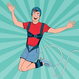 Pop art aufgeregter mann, der bungee springt