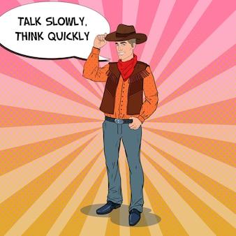 Pop-art-cowboy im hut, der mit comic-sprechblase lächelt