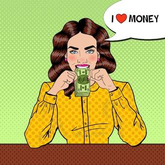 Pop art erfolgreiche junge schöne frau, die geld isst.