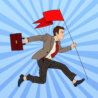 Pop-art-geschäftsmann, der mit roter fahne zum erfolg läuft.
