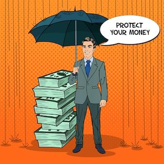 Pop art glücklicher geschäftsmann, der geld vor regen mit regenschirm schützt. comic-sprechblase. retro illustration