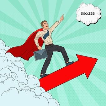 Pop art hero super businessman fliegen durch die wolken. geschäftsmotivation führung.