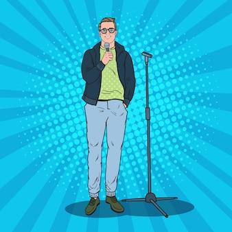 Pop art hübscher mann mit mikrofon