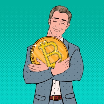 Pop art junger geschäftsmann, der große bitcoin-münze hält