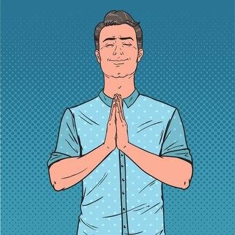 Pop art junger mann, der mit lächeln betet