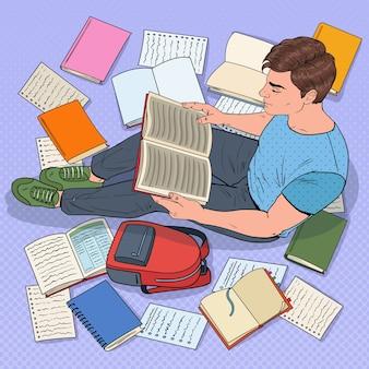 Pop art männlicher student, der bücher liest, die auf dem boden sitzen. teenager, der sich auf prüfungen vorbereitet. bildungs-, studien- und literaturkonzept.