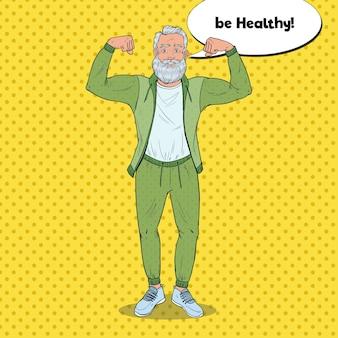 Pop art reifer älterer mann, der muskeln zeigt. glücklicher starker großvater. gesunder lebensstil.