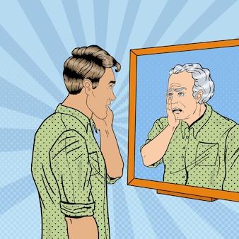 Pop art schockierte mann, der sich im spiegel älter ansieht. illustration