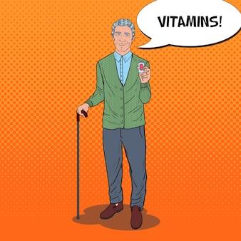 Pop art senior man hält pillen