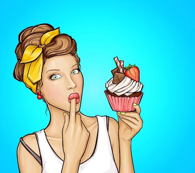 Pop-art sexy mädchen mit süßem cupcake