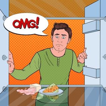 Pop art unglücklicher hungriger mann, der im leeren kühlschrank schaut